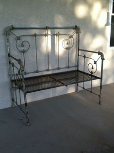 Antique metal bed frame turned into garden bench. Headboard is the back rest & footboard cut in 2 for the sides.