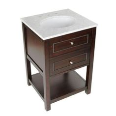 """Madison 24"""" Vanity 24 in. W x 22 in. D x 35 in. H Constructed with solid wood, wood veneer and low-emission engineered wood.    Marble vanity top included with pre-attached china undermount sink Vanity top pre-drilled for 4 in. centerset faucet for easy installation - faucet sold separate"""