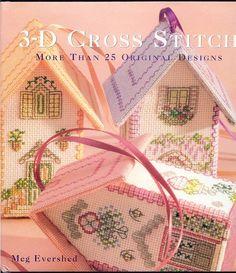 Livre sur maison 3D au point de croix
