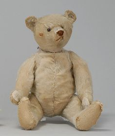 STEIFF BEAR Circa 1920  In blonde mohair, mostly missing. Glass eyes