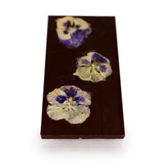 Belgian dark chocolate with dried fruits and candied flowers. We have imagined and created the Eden full of flowers and fruits. Pansies are such grateful flowers that they rejoice you with their bloom and graceful beauty both in spring and autumn. We candy the garden pansies one by one, with greatest care so that they maintain their perfect shape and colour. As far as we know, it is just our artisan chocolate factory in Europe which candies garden pansies. Fleur Design, Artisan Chocolate, Chocolate Factory, Sunflower Oil, Vanilla Flavoring, Dried Cranberries, Pansies, Autumn, Flowers