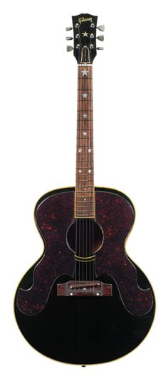 """GALLERY: Vintage Gems from Christie's Guitar Auction - Premier Guitar    1963 Gibson Everly Brothers J-180  Serial number 64520, this J-180 features a truss-rod cover engraved """"EVERLY"""" and is expected to sell for $5,000–$7,000."""