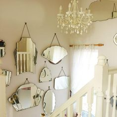 Create a unique and quirky alternative to traditional wall art by grouping together vintage mirrors of all different shapes, sizes and styles.