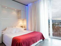 Most of the 28 rooms in Hotel 54 Barceloneta, a hostel in the increasingly trendy fishing quarter, have fantastic views of Port Vell, and all have Wi-Fi. The decor is light and airy, with playful touches like neon mood lighting and bathrooms with green-glass sinks.   Strengths: Near the beach