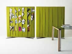 WGS Wall is an awesome room divider designed by Gallotti & Radice. It isn't only good looking because of felt covering but also very practical. It could accommodate all magazines and books you're currently reading or going to read or be used as a displayer of family photographs or something similar. Besides it has good sound absorbing qualities. Under the felt is wooden structure supported by bright stainless steel feet. The felt comes in large variety of colors.
