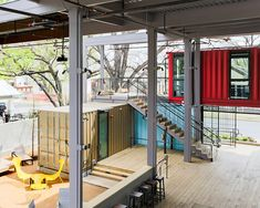 north arrow studio re-purposes shipping containers into stacked bar in texas