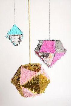 Love these geometric piñatas