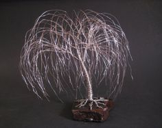 This is a very unique piece of art with a full 3-D look. This piece is made from bronze wire that is a little more expensive than the standard color of wire that is used in the other sculptures.  The tree pictured is approximately 10  (25cm) tall, has about 180 limbs, and roots that are approximately 30 (76cm) for a full length of approximately 40 (102cm). The 24 (61cm) tree has a 6 (15cm) tree and about 18 (46cm) of roots. The 32 (81cm) tree has a tree size of about 8 20cm) with about 24…