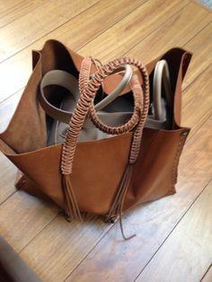 A Lindy Hermes inside a Callista bag