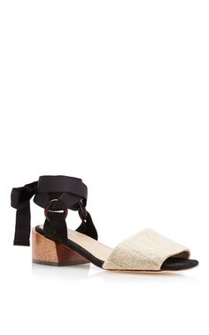 This **Mari Giudicelli** Canna sandal is rendered in raffia and features an open toe and calfskin lining.