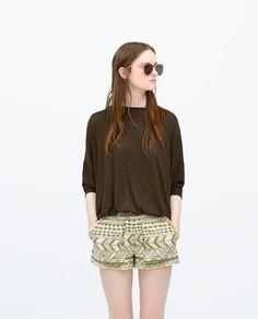 Afbeelding 1 van T-SHIRT MET VLINDERMOUW van Zara