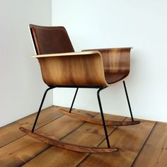 "This the ""Roxy"" chair, made by me. The seat and seat back are molded plywood veneered in Walnut. Curved foam cushions wrapped in brown or black leather, or charcoal tweed. The base is welded steel in a matte black durable powder-coated finish. The rocker skids are solid walnut. Chair measures 28"" wide, 30"" tall, 30"" deep. Made to order in 4-8 weeks. Shipped disassembled, easily assembled."
