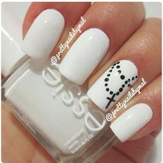 Whie Essie polish with Christ symbol accent nail