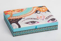 Shri Krishna Box, Aqua :  Elevate the bedroom, office or lounge while adding a bright flash of colour. This Shri Krishna fabric box is perfect for storing jewellery, keepsakes or as an artful accessory. The ideal gift for any home.
