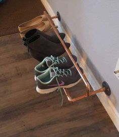 This copper pipe shoe rack makes it easy to organize and keep shoes neat and tidy. Easily vacuum or mop under your shoes. Installs in studs on center) or use wall anchors to secure this stylish rack. (Hardware not included) Picture shows the 32 inch mo Best Shoe Rack, Diy Shoe Rack, Shoe Racks, Wall Shoe Rack, Wall Shoe Storage, Wall Mounted Shoe Rack, Shoe Wall, Laundry Storage, Laundry Room