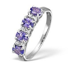 Tanzanite 0.65ct And Diamond 18K White Gold Ring - Item N4390.  #tanzanitering #engagementring #engagement #ring #diamondstoreuk #whitegold #tanzanite