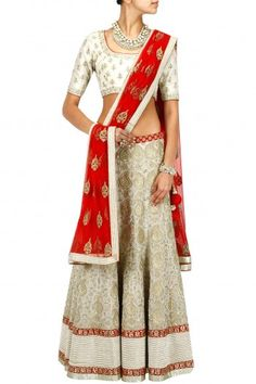 SVA This lehenga set features a white rawsilk blouse with gold aari embroidery. It comes along with matching jamawar lehenga with aari and pearls embroidery all over. Indian Bridal Outfits, Indian Bridal Wear, Indian Wear, Wedding Outfits, Pakistani Dresses, Indian Sarees, Indian Dresses, Indian Inspired Fashion, Asian Fashion