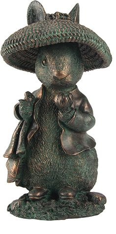 Benjamin Bunny Figure  --  Beatrix Potter is world renown for her books and illustrations featuring Peter Rabbit and friends. She was also a conservationist and with her publishing proceeds she purchased tracts of land in Cumbria, England in order to preserve it; presently known as Lake District National Park. One of her most popular characters here in bronzed polyresin.
