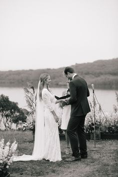 Whitney Weeks and Doug Pickett's Wedding:    Exchanging rings! Photo: Lucy Cuneo