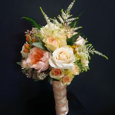 Designed by #LiliesWhite.....a bridal bouquet featuring #astilbe, wax flower, #juliet garden roses, vandella roses,  porcelina #sprayroses and #hypericum berries