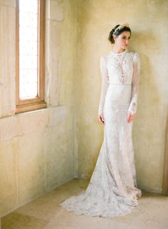 High neckline long sleeve one of a kind Inbal Dror wedding gown: http://www.stylemepretty.com/2016/12/15/best-wedding-dresses-of-2016/ Photography: Jose Villa - http://josevillablog.com/