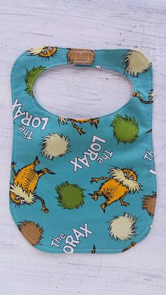 Check out this item in my Etsy shop https://www.etsy.com/listing/258788596/dr-suess-the-lorax-organic-cotton-bib