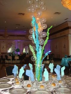 Under The Sea Theme Centerpieces Sea Kelp with Balloon Bubbles. Rent Beach Themed Centerpieces Under The Sea Theme Tropical Theme Ideas email info@sweet16candelabtas.com Call for a free price quote (631) 421-2286. www.sweet16candelabras.com  YouTube channel www. youtube/sweet16candleabras