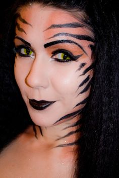 Tiger Goddess Makeup ~ I think something similar to this might be okay. Maybe a little more around eyes and a little across the cheeks.