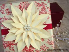 DIY paper poinsettia gift topper
