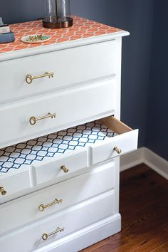 This beautiful dresser was a consignment store find badly in need of a makeover. Fresh paint and new cabinet hardware made it like new again. Then the stenciled pattern on the top and inside the drawers made this dresser something special. Click through to see our dresser makeover tutorial.