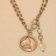 Very rare Vintage Man O'War solid silver commemorative coin hanging from pyrite and freshwater pearls wire-wrapped on sterling silver chains with bezel set cubic zirconia chain. This coin is two sided