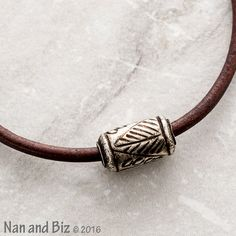 Our mens leather bracelet is created from 3mm antique brown leather cord…