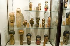 Glass cabinet with prize winning kokeshi dolls