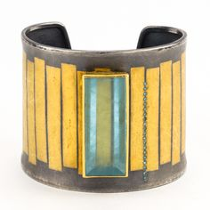 Atelier Zobel - Cuff Oxidized sterling silver 22k gold inlay, aquamarine gemstone (47.74 ct), 24k gold bezel, and an accent of blue diamonds.