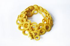 ON SALE REGULAR PRICE €75 NOW €60!!   Warm Chunky scarf , Fall accessory yellow wool scarf, chunky infinity scarf , Crochet circle scarf, Knit infinity scarf, cowl scarf, Cashmere    > Handmade neckwarmer cashmere crochet rings and ceramic < Rings are crocheted in yellow 100% cashmere with a ceramic button closure. The necklace-neckwarmer in luxury cashmere is a perfect accessory for the fashion winter. It can be worn in so many ways, as warm and light perfect gift for the winter. In the…