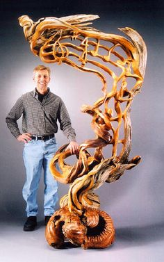 Christopher-White.\ These wood sculptures are carved by J. Christopher White from Loveland, Colorado, USA.