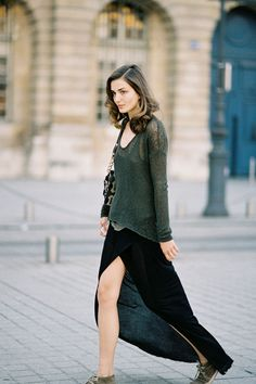 Model, Andreea Diaconu in between shows during Paris Fashion Week wearing our Asymmetric Sweater and Side Slit Skirt.