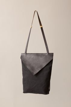 """Bag: Flex Pack / rucksack - leather (14 x 2.5 x 4"""") - Chiyome $278  Black veg tanned leather flap, waxed canvas body. Grey/black leather strap converts from backpack to shoulder bag.  Brass hardware, interior pocket, hand painted edges.  Each bag is made by hand."""