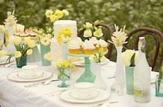 Milk glass mixed with jadite makes for a gorgeous arrangement on reception tables at a wedding.