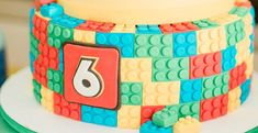 You are sure to build a lot of fun ideas with this fabulous Lego Birthday Party by BronwynSerradinho, out of Polokwane, Limpopo, South Africa! Scattered with bright colors, adorable lego themed sweets and custom lego decor, this event is for all to explore! So start stacking and build until you drop and be sure to include these details that really pop: Awesome Lego Birthday CakeCustom Lego BackdropLego Head Cake Pops Lego Themed CookiesColorful Lego Man BannersLego Sack Table Settings with P