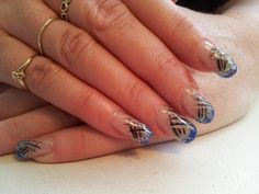 acylic nails with royal blue glitter and hand painted art work