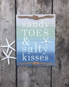 A personal favorite from my Etsy shop https://www.etsy.com/listing/516301636/beach-sign-sandy-toes-salty-kisses-beach