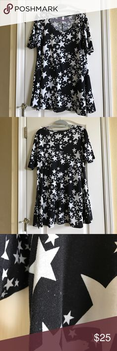 LuLaRoe perfect T Excellent used condition LuLaRoe perfect T in size small. Black background with white stars. Some slight pilling (third photo) in some places. Barely noticeable. Not other signs of wear. Material is t-shirt like, not leggings. PRICE IS FIRM. LuLaRoe Tops