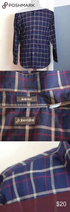 Sale! St. John's Bay Plaid Dress Shirt - Med. St. John's Bay iron free long sleeve button down shirt.  It's navy plaid with red, white and mustard in the pattern.  This is a size medium shirt. It's 60% cotton, 40% polyester.  It's been worn, but is in great condition.  On sale today! All menswear $10 PLUS bundle discount. Stock up while you can! Reasonable offers accepted, but no low ball offers, please. St. John's Bay Shirts Dress Shirts