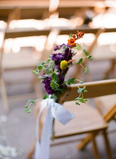 Modern aisle decor in rich purple with hints or orange and yellow