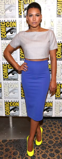 Naya Rivera joined her Glee co-stars at Comic-Con in San Diego for a panel discussion wearing this mixed separates ensemble. She paired an grey Razan Alazzouni crop top with a sleek, blue, H high-waisted pencil skirt.    A chic ponytail, nude lip and fluorescent yellow Guiseppe Zanotti heels completed her look.