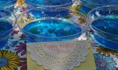 puppy dog themed birthday party 191...love the jello water bowls and the hot dog bar idea. A little much, but some cute ideas
