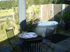 Outdoor tub?  Yes please!  Tin Dragon Trail Cottages: Private courtyard