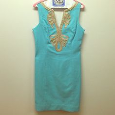 """Lilly Pulitzer """"Janice"""" Blue & Gold Shift Dress Size 2.  Worn once to my sister's baby shower. Blue shift dress with gold embellishment at bust and neck.  Sleeve with notched v-neck and scoop back.  Princess seams and back zip closure.  Lined.  100% cotton. Lilly Pulitzer Dresses"""