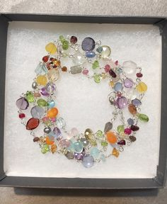 This is one of my favorite necklaces... you can wear long at 36 inches or double it up.  So many gemstones including: sapphires, garnet, amethyst, citrine, iolite, prehnite, peridot, and many more.... www.sarahcornwelljewelry.com gemstone jewelry, unique jewelry, hand made jewelry, gift for mom, delicate jewelry, layering jewelry, natural gemstones